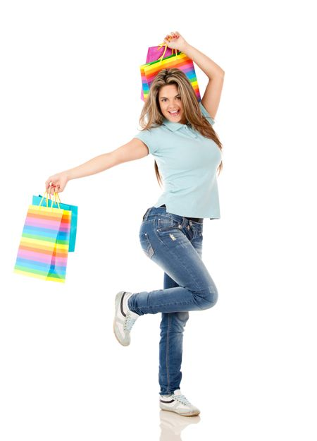 Happy shopping woman jumping isolated over white