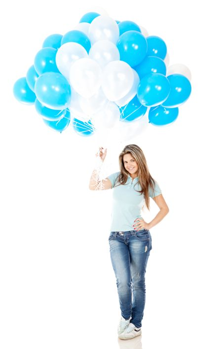 Happy girl holding a bunch of hot-air balloons - isolated