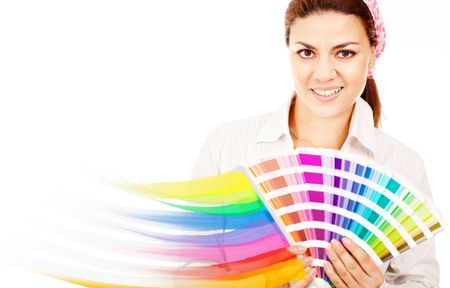 Female decorator holding a color guide and smiling