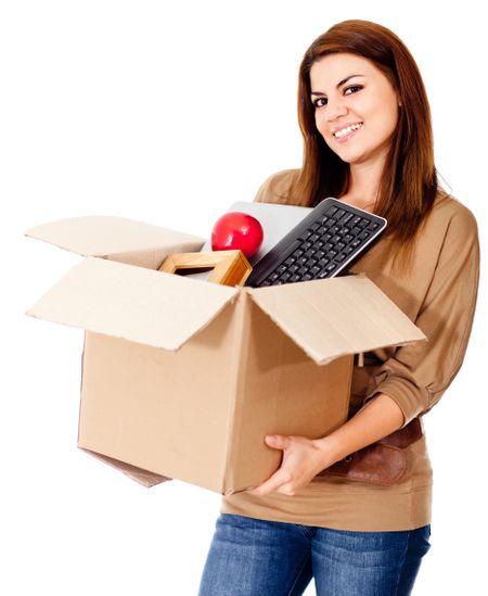 Woman moving house and holding a box - isolated over a white background