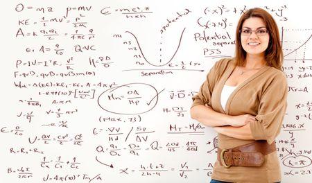 Math teacher with a board full of formulas