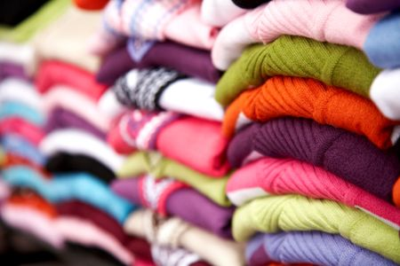 multi colour woolen sweaters in a retail store