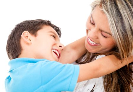 Loving mother and son smiling - isolated over a white background