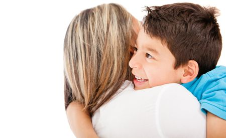 Son hugging his mother - isolated over a white background
