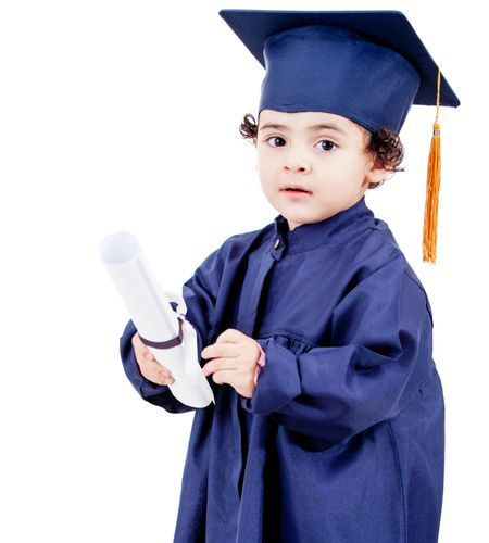 Little boy graduating from preschool - isolated over a white background