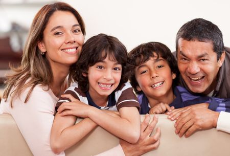 Portrait of a happy family together at home smiling