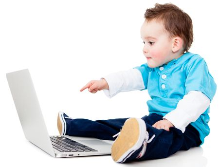 Boy pointing at the screen of a laptop computer - isolated over white