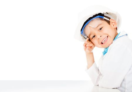 Boy with a helmet playing to be an engineer - isolated