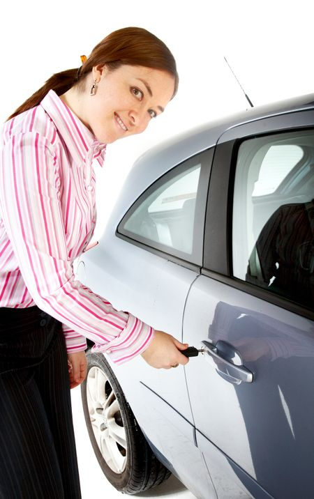business woman openin the door of her new car isolated over a white background