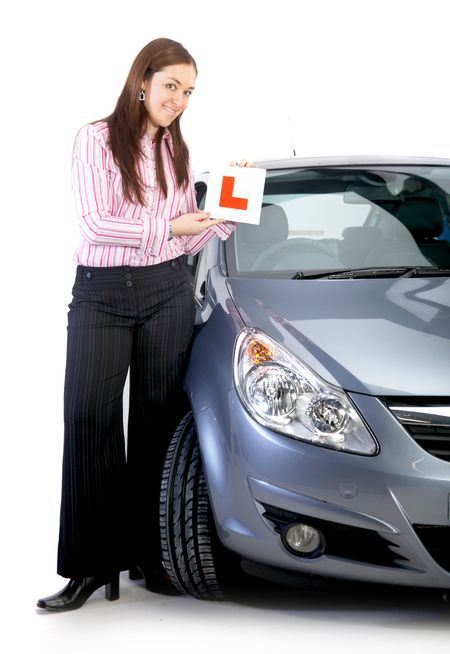 business woman learning to drive in her new car - isolated over a white background