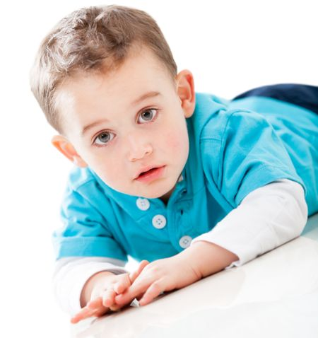 Boy lying on the floor - isolated over a white background