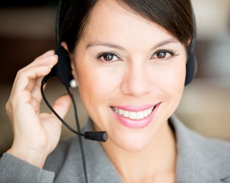 Female customer support operator with a headset