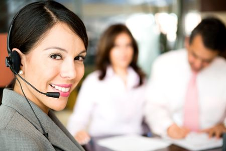 Friendly woman working as a telemarketing agent