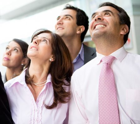 Portrait of a successful business team looking up