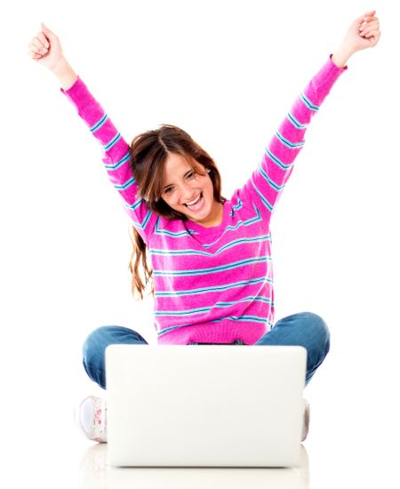 Excited woman with a laptop and arms up - isolated over white