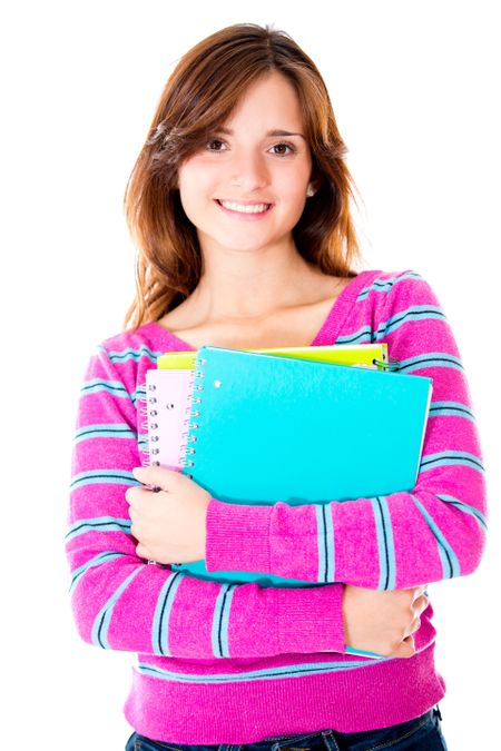 Casual female student holding notebooks - isolated over white