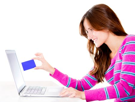 Woman shopping online through her computer - isolated over white