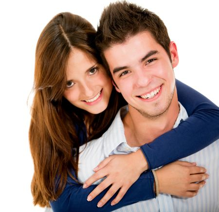 Young loving couple - isolated over a white background