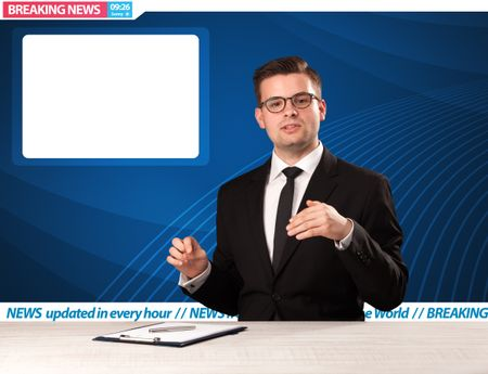 Television reporter telling breaking news at his studio desk with copy space concept