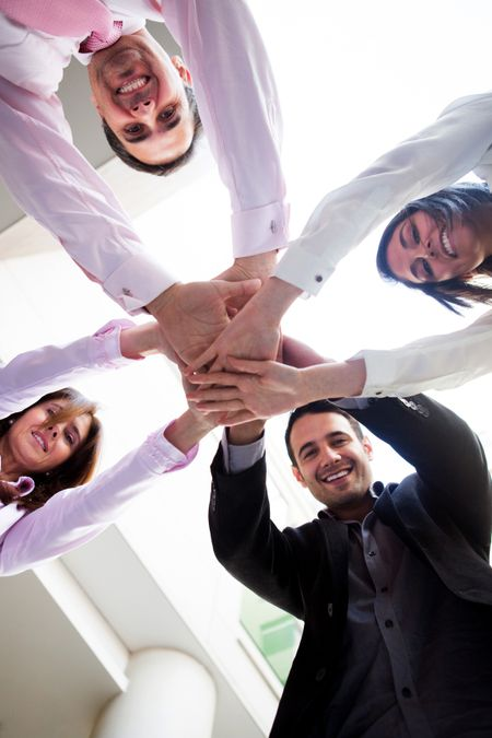 Successful business group with hands together � teamwork concepts