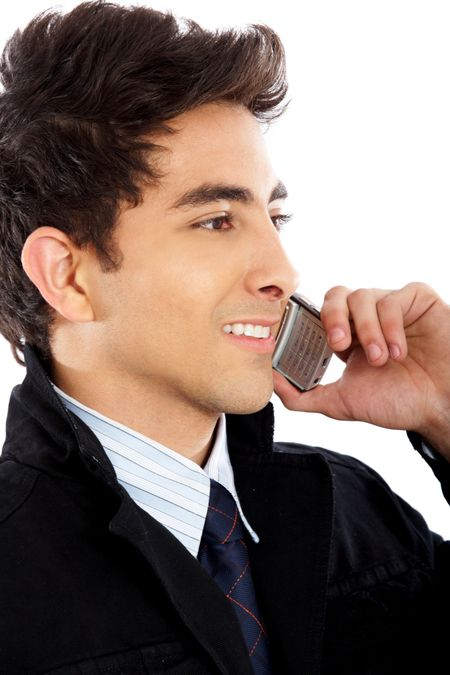 Business man on the phone smiling isolated over a white background