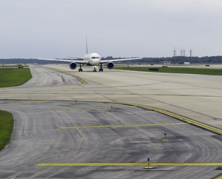 Passenger jet taxiing along runway before takeoff