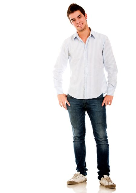 Casual young man standing isolated over a white background