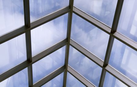 Skylight with reflections and blue sky