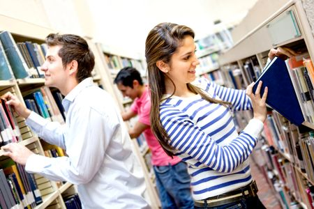 Group of students at the library choosing books