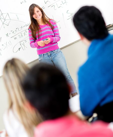 Female student standing in front of a class