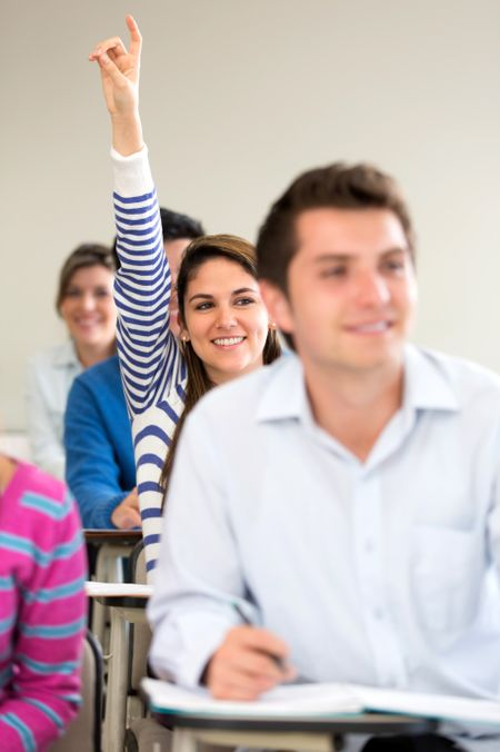 Female student participating in class raising her hand