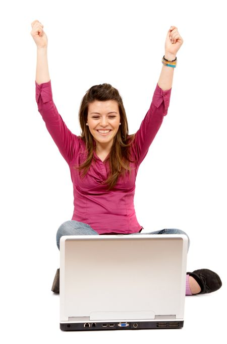 casual girl success on the internet on a laptop computer isolated over a white background