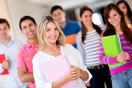 Female student with a group of friends looking happy