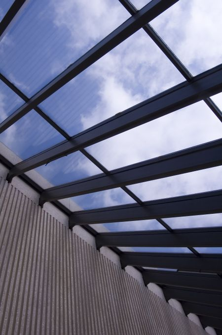 Section of a skylight with blue sky and clouds
