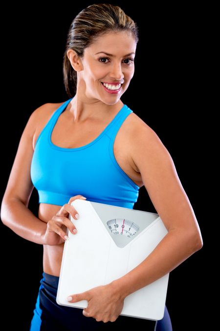 Weight Loss Woman Holding A Scale Isolated Over A Black Background Freestock Photos