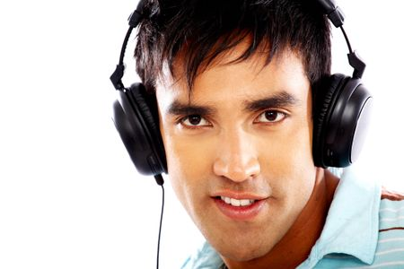 man looking happy listening to music on his headphones isolated over a white background