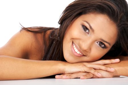 beautiful woman face smiling and leaning on her hands