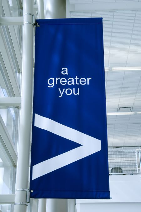 "Banner in college hallway: ""a greater you"""