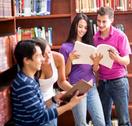 Group of students at the library reading books