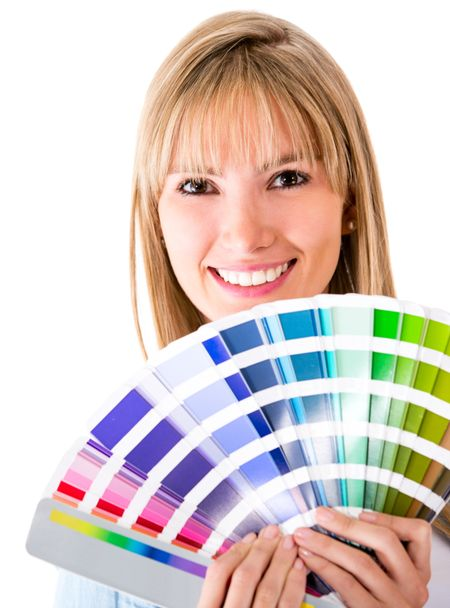 Happy woman selecting a color to paint the house - isolated over white