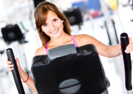 Beautiful woman at the gym looking happy