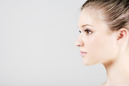 Young woman in a beauty style pose in profile