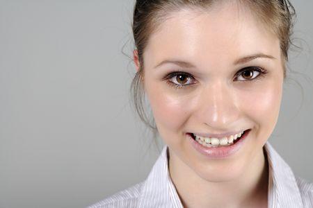 Young woman in smart shirt facing the camera