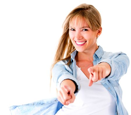 Woman having fun pointing to the camera - isolated over a white background