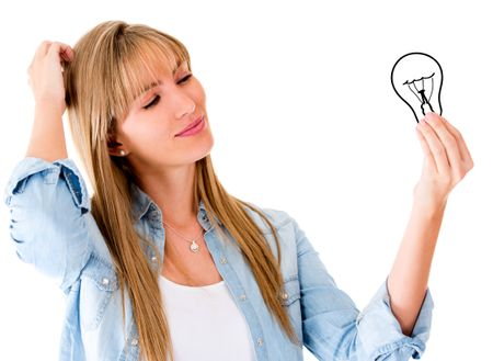 Thoughtful woman having an idea and holding a bulb