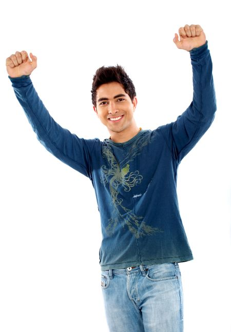 casual man looking happy with arms up isolated over a white background