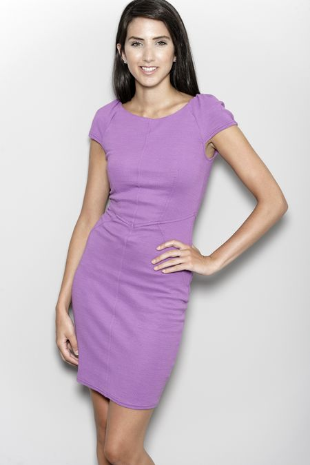 Professional working woman in corporate purple dress