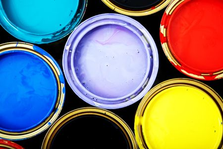 buckets of paint in different bright colours