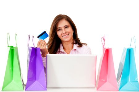 Happy woman shopping online - isolated over a white background