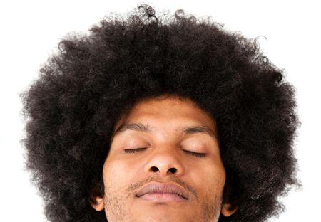 Afro man with eyes closed - isolated over a white background